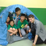 My happy students in a tent they pitched