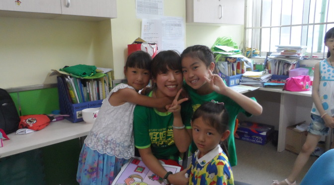 Happy Chinese teacher and students