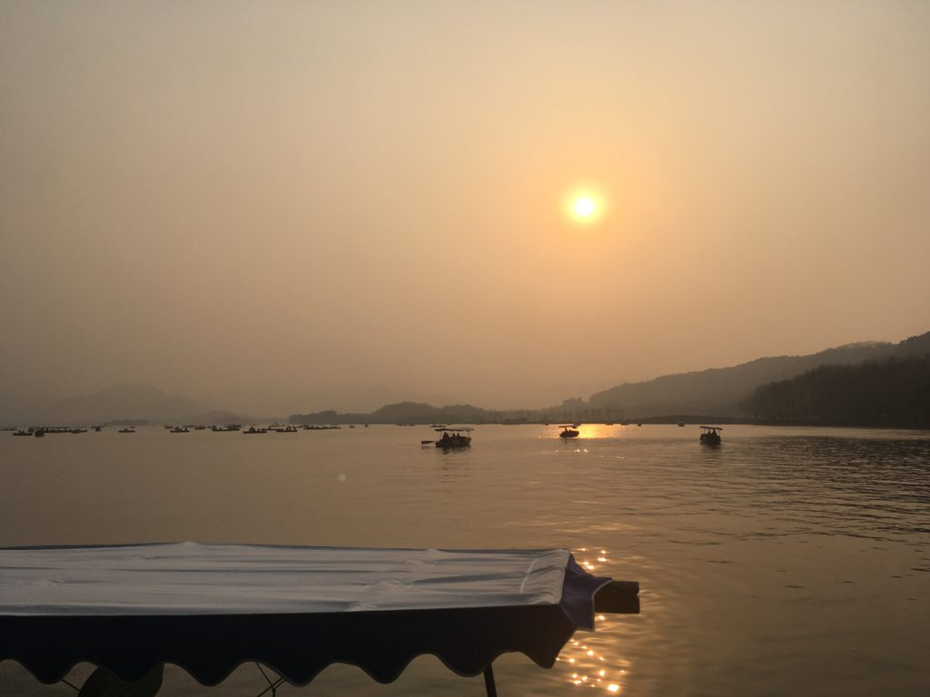 Sunset over West Lake, one of the most popular tourist attractions in China.