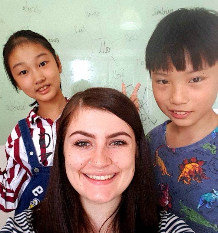 Me with 2 of my students at i2 education Guizhou China