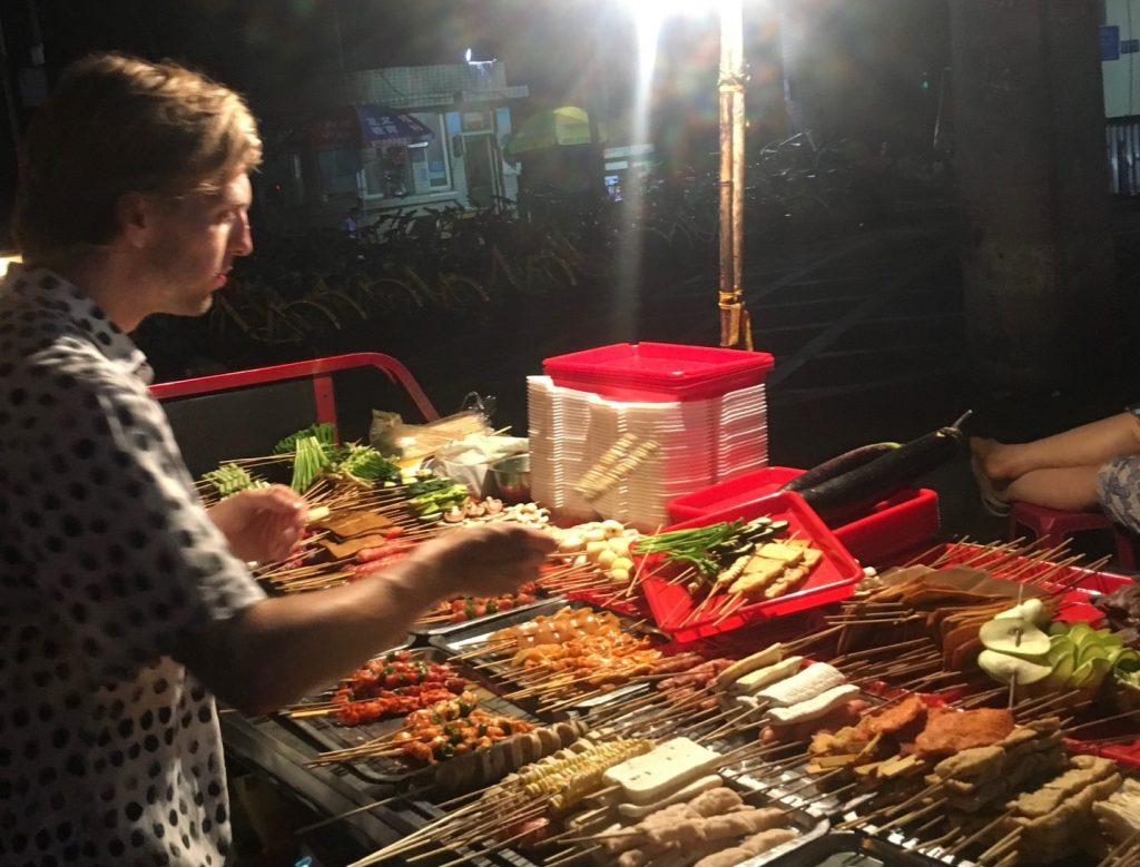 Westerner ordering Chinese street BBQ