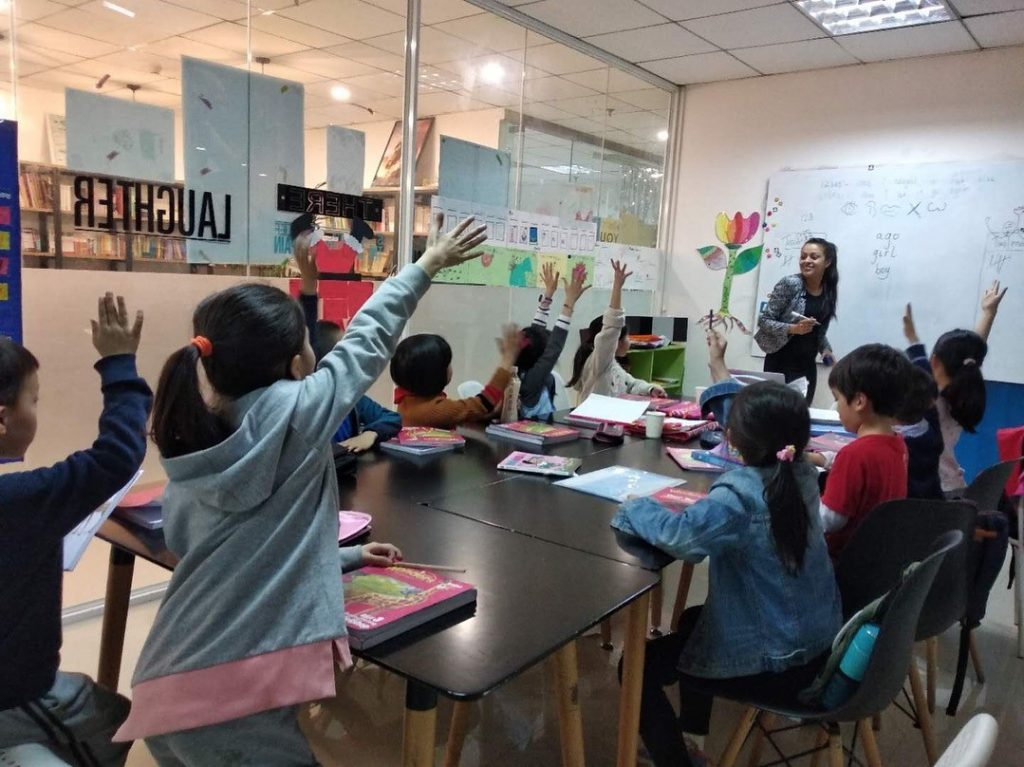 Busy happy TEFL teacher class at UP school Chengdu