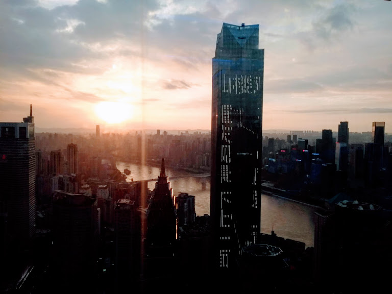 Chongqing cityscape view with a new high rise tower under construction in the center foreground