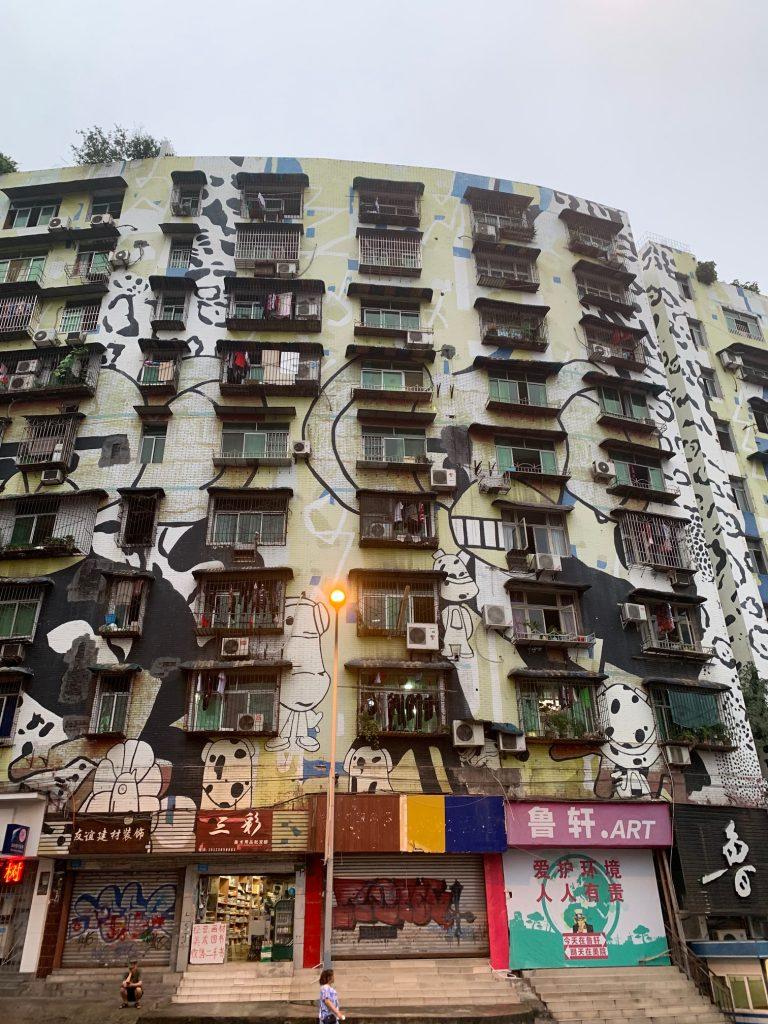 Apartment block and shops in Chongqing with panda graffiti