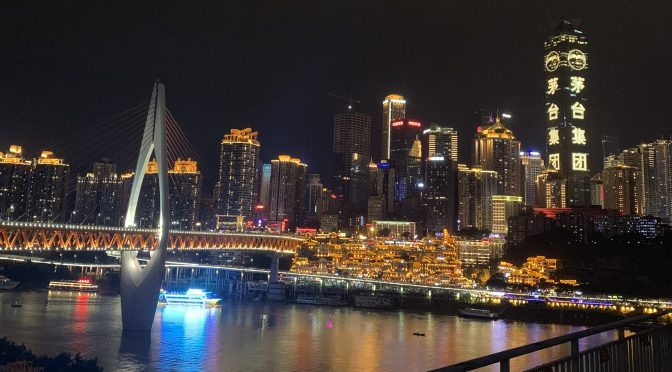 Skyline of Chongqing city at night with the bridge